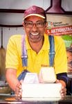 picture of Elias Mamo, selling cheese in his stall at Erlangen's Martkplat