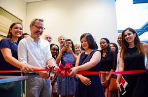 "Picture of our Students and Michael Krennerich cutting the ribbon to open their exhibition ""Starting Over!"""