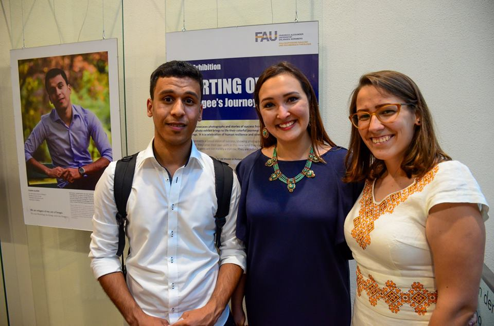 Photo of two members of the Photo Exhibit Team with one of the Interviewees for the Installation