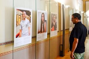Photo of one of the Interviewees walking through the Exhibition