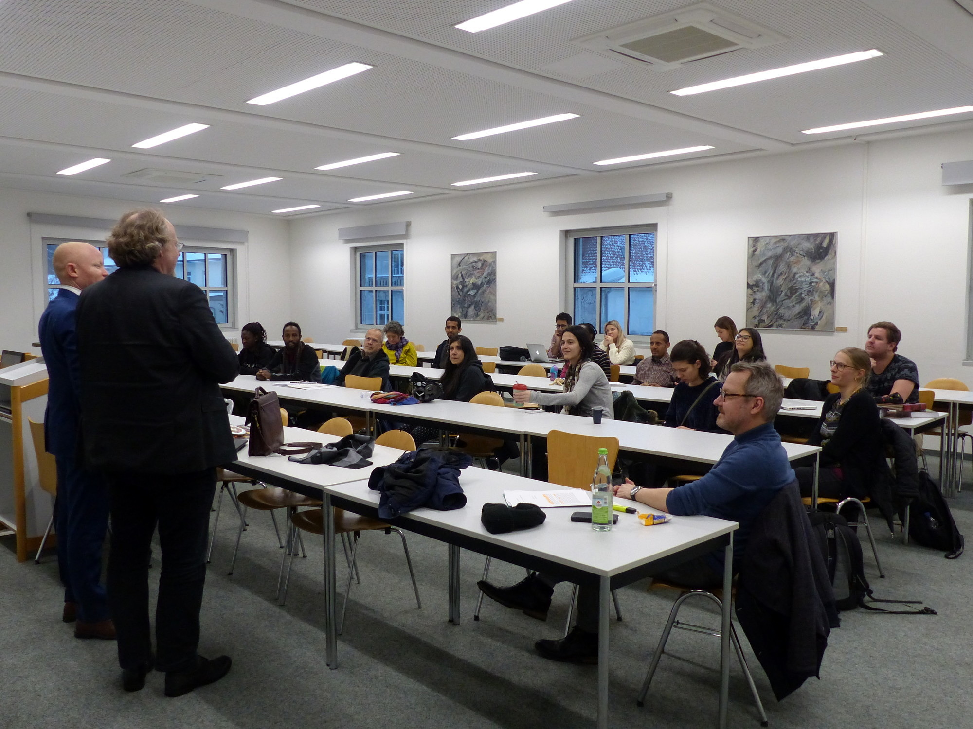 Prof. Bielefeldt introduces Ambassador Possi to a group of M.A. Human Rights Students