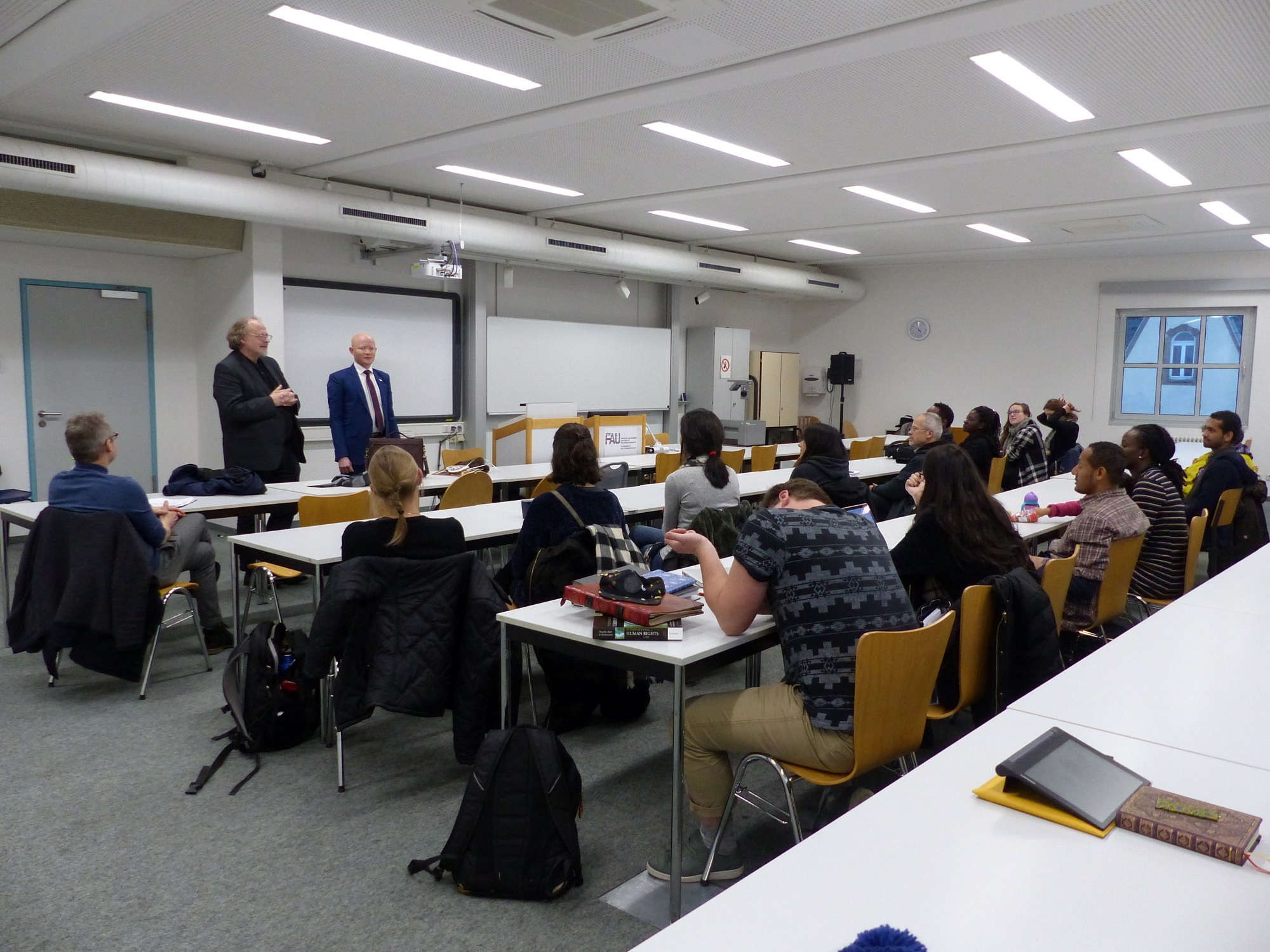 Prof. Bielefeldt introduces Dr. Possi to a group of human rights students