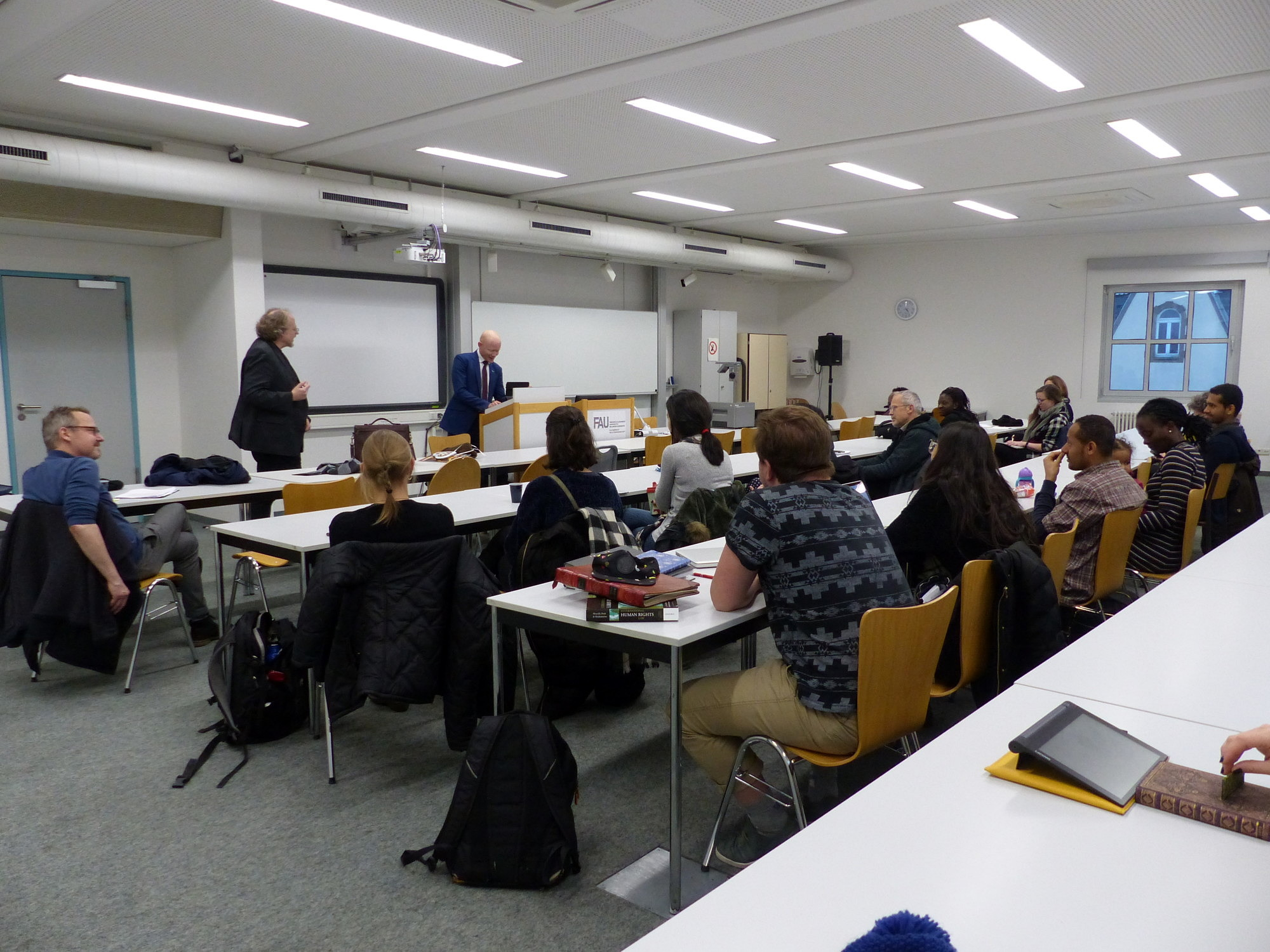 Picture of Ambassador Possi speaking to the Human Rights Class