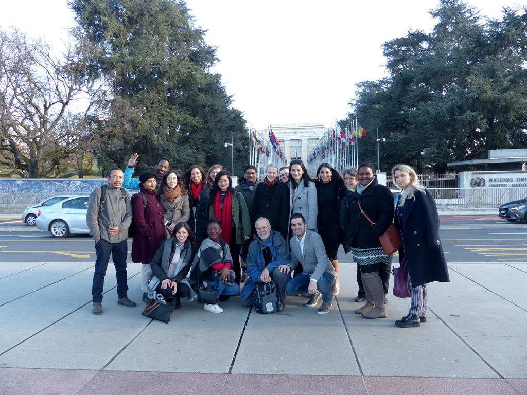 A group of Human Rights students in front of the Palais de Nations at the United Nations
